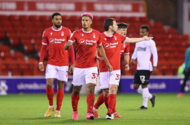 Lyle Taylor of Nottingham Forest celebrates with teammates after scoring his team's first goal during the Sky Bet Championship match between Nottingham Forest and Brentford at City Ground on October 23, 2020 in Nottingham, England. Sporting stadiums around the UK remain under strict restrictions due to the Coronavirus Pandemic as Government social distancing laws prohibit fans inside venues resulting in games being played behind closed doors. (Photo by Alex Pantling/Getty Images)