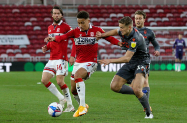 : Middlesbrough's Marcus Tavernier shields the ball from Nottingham Forest's Ryan Yates during the Sky Bet Championship match between Middlesbrough and Nottingham Forest at Riverside Stadium on October 31, 2020 in Middlesbrough, England. (Photo by Alex Dodd - CameraSport via Getty Images)