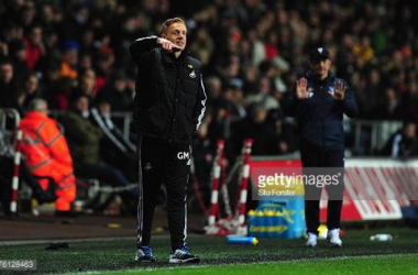 Garry Monk and Tony Pulis (above) competing against each other in the Premier League, at previous clubs.