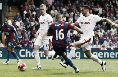 Dwight Gayle nets the first of his two goals yesterday. Photo: Stefan Wermuth/ Reuters.