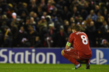Gerrard kneels on the Anfield turf following the final whistle, dejected after his side failed to make it through.