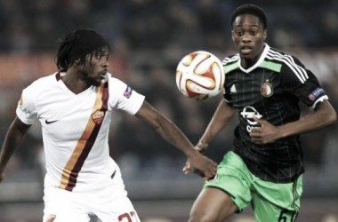 Gervinho and Terence Kongolo battle for possession of the ball.