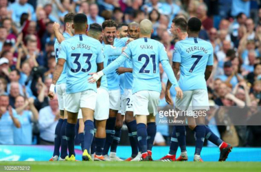 Manchester City celebrate in front of their supporters (Photo credit: Alex Livesey, Getty Images)