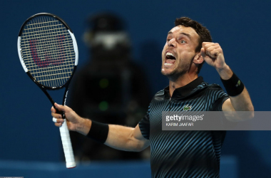 Bautista Agut reacts after his victory over Djokovic/Photo: Karim Jaafar/Getty Images
