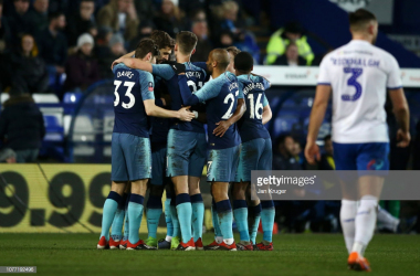 Spurs celebrate Aurier's stunner. (Photo: Getty Images/Jan Kruger)