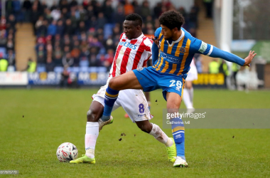Peter Etebo and Josh Laurent battle for the ball
