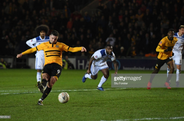 Amond scores the winner. (Photo: Getty Images/Stu Forster)