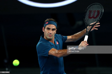 Federer plays a backhand in his first-round victory/Photo: Michael Dodge/Getty Images