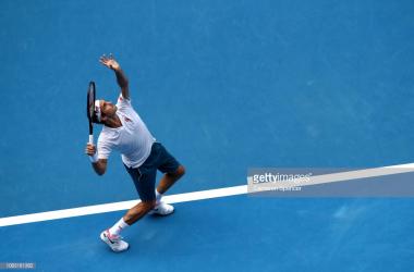 Federer in action vs Evans (Cameron Spenver/Getty Images)