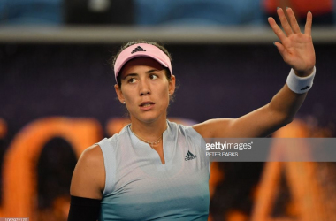 Muguruza waves to the crowd after her late-night victory/Photo: Peter Parks/Getty Images
