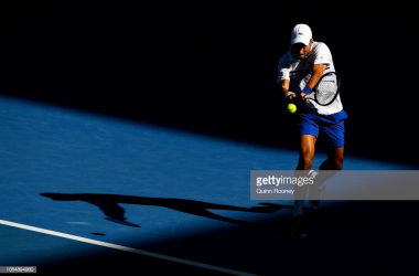 Novak Djokovic hitting a backhand (Quinn Rooney/Getty Images)