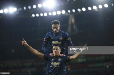 Arsenal v Manchester United - FA Cup Fourth RoundLONDON, ENGLAND - JANUARY 25: Alexis Sanchez of Manchester United celebrates scoring their 1st goal with Jesse Lingard during the FA Cup Fourth Round match between Arsenal and Manchester United at Emirates Stadium on January 25, 2019 in London, United Kingdom. (Photo by Marc Atkins/Getty Images)