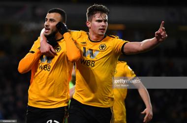 Romain Saiss and Leander Dendoncker celebrate a Wolves goal against West ham in the Premier League / getty images / Photo by: Clive Mason