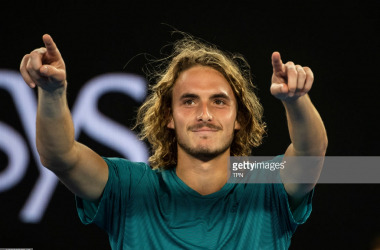 Stefanos Tsitsipas points to his box after upsetting Roger Federer (TPN/Getty Images)