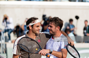 Federer and Wawrinka share a nice moment after their quarterfinal match (Peter Staples/ATP Tour)