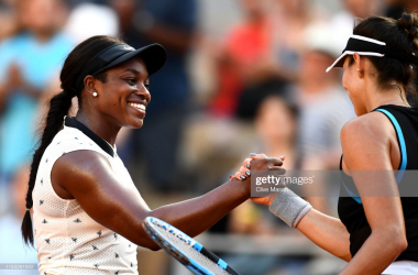 Stephens and Muguruza meet at the net following their encounter, in which the American prevailed (Getty Images/Clive Mason)