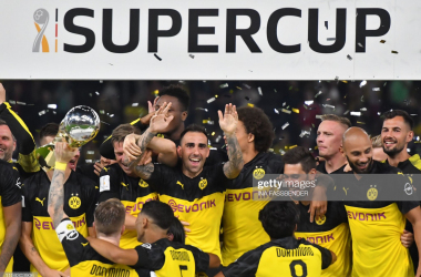 The Dortmund players celebrate winning the DFL Supercup (INA FASSBENDER/Getty Images)