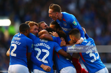 Portsmouth players celebrate during their Carabao Cup victory/Photo: Dan Istitene/Getty Images