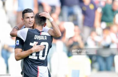 Juventus' Cristiano Ronaldo celebrates his weekend goal against S.P.A.L with teammate Paulo Dybala (Getty Images/Daniele Badolato)
