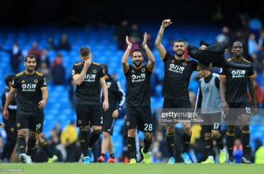 Joao Moutinho of Wolves (C) and Patrick Cutrone of Wolves celebrate victory after the Premier League match between Manchester City and Wolverhampton Wanderers at the Etihad Stadium on October 6, 2019 in Manchester, United Kingdom. (Photo by Simon Stacpoole/Offside/Offside via Getty Images)