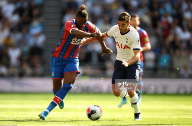 <div>LONDON, ENGLAND - SEPTEMBER 14: Harry Winks of Tottenham Hotspur battles for possession with Wilfried Zaha of Crystal Palace during the Premier League match between Tottenham Hotspur and Crystal Palace at Tottenham Hotspur Stadium on September 14, 2019 in London, United Kingdom. (Photo by Paul Gilham/Getty Images)</div>