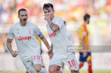 Juventus' Paulo Dybala celebrates his goal against Lecce with teammate Leonardo Bonucci (Getty Images/Daniele Badolato)