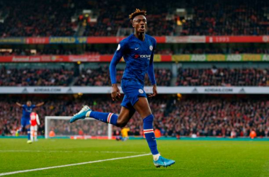 Chelsea's English striker Tammy Abraham celebrates scoring their second goal to take the lead 1-2 during the English Premier League football match between Arsenal and Chelsea at the Emirates Stadium in London on December 29, 2019. (Photo by Ian KINGTON / IKIMAGES / AFP) / RESTRICTED TO EDITORIAL USE. No use with unauthorized audio, video, data, fixture lists, club/league logos or 'live' services. Online in-match use limited to 45 images, no video emulation. No use in betting, games or single club/league/player publications. (Photo by IAN KINGTON/IKIMAGES/AFP via Getty Images)