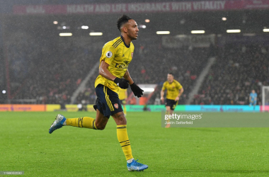 BOURNEMOUTH, ENGLAND - DECEMBER 26: Pierre-Emerick Aubameyang of Arsenal celebrates after scoring his team's first goal during the Premier League match between AFC Bournemouth and Arsenal FC at Vitality Stadium on December 26, 2019 in Bournemouth, United Kingdom. (Photo by Justin Setterfield/Getty Images)