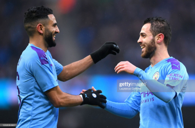 <div>MANCHESTER, ENGLAND - JANUARY 26: Bernardo Silva of Manchester City celebrates after scoring his team's second goal with Riyad Mahrez during the FA Cup Fourth Round match between Manchester City and Fulham at Etihad Stadium on January 26, 2020 in Manchester, England. (Photo by Laurence Griffiths/Getty Images)</div><div><br></div>