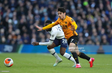 LONDON, ENGLAND - MARCH 01: Tanguy Ndombele of Tottenham Hotspur and Pedro Neto of Wolverhampton Wanderers during the Premier League match between Tottenham Hotspur and Wolverhampton Wanderers at Tottenham Hotspur Stadium on March 1, 2020 in London, United Kingdom. (Photo by Matthew Ashton - AMA/Getty Images)
