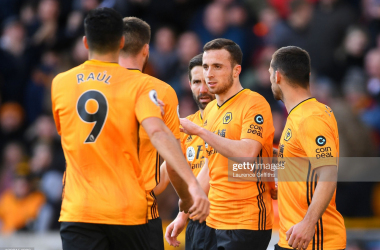 WOLVERHAMPTON, ENGLAND - FEBRUARY 23: Diogo Jota of Wolverhampton Wanderers celebrates with teammates after scoring his team's first goal during the Premier League match between Wolverhampton Wanderers and Norwich City at Molineux on February 23, 2020 in Wolverhampton, United Kingdom. (Photo by Laurence Griffiths/Getty Images)
