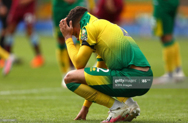 Max Aarons cuts a dejected figure as Norwich City's relegation to the Championship is confirmed - (Photo by Richard Calver/SOPA Images/LightRocket via Getty Images)