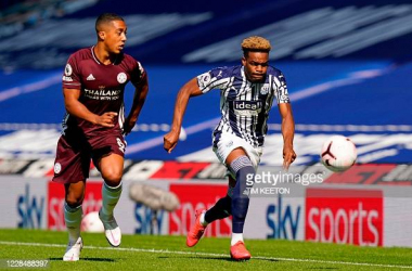 Youri Tielemans (left) hunts down possession of the ball. (Photo by Tim Keeton - Pool/Getty Images)