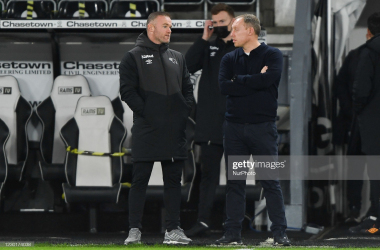 Wayne Rooney of Derby County chats with Steve Cooper, manager of Swansea ahead of kick-off during the Sky Bet Championship match between Derby County and Swansea City at the Pride Park, Derby on Wednesday 16th December 2020. (Photo by Jon Hobley)