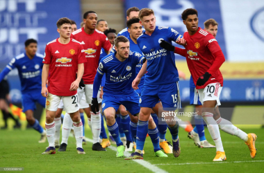 Players jostle for position as a free kick is delivered during the Premier League match between Leicester City and Manchester United at The King Power Stadium on December 26, 2020 (Photo by Marc Atkins/Getty Images)