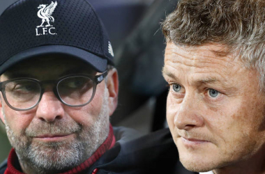Manchester United v Liverpool FC - Premier LeagueFILE PHOTO (EDITORS NOTE: COMPOSITE OF IMAGES - Image numbers 1178800802,856402376 - GRADIENT ADDED) In this composite image a comparison has been made between Ole Gunnar Solskjaer, Manager of Manchester United (L) and Liverpool manager Jurgen Klopp. Manchester United and Liverpool FC meet in the Premier League fixture on October 18, 2019 at Old Trafford in Manchester. ***LEFT IMAGE*** THE HAGUE, NETHERLANDS - OCTOBER 03: Ole Gunnar Solskjaer, Manager of Manchester United looks on prior to the UEFA Europa League group L match between AZ Alkmaar and Manchester United at ADO Den Haag on October 03, 2019 in The Hague, Netherlands. (Photo by Bryn Lennon/Getty Images) ***RIGHT IMAGE*** NEWCASTLE UPON TYNE, ENGLAND - OCTOBER 01: Liverpool manager Jurgen Klopp looks on during the Premier League match between Newcastle United and Liverpool at St. James Park on October 1, 2017 in Newcastle upon Tyne, England. (Photo by Ian MacNicol/Getty Images)