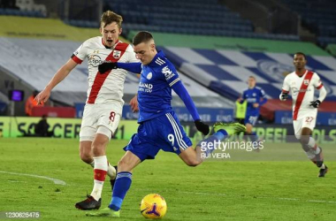 Jamie Vardy takes a shot under pressure from James Ward-Prowse