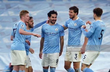 anchester City's German midfielder Ilkay Gundogan (C) celebrates with teammates after scoring their second goal during the English Premier League football match between Manchester City and Crystal Palace at the Etihad Stadium in Manchester, north west England, on January 17, 2021. (Photo by Dave Thompson)