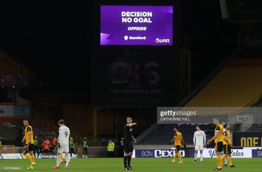 "A screen displays the ""No Goal"" VAR decision following a review of Leeds United's English striker Patrick Bamford's (unseen) disallowed goal during the English Premier League football match between Wolverhampton Wanderers and Leeds United at the Molineux stadium in Wolverhampton, central England on February 19, 2021. (Photo by Catherine Ivill / POOL / AFP) / RESTRICTED TO EDITORIAL USE. No use with unauthorized audio, video, data, fixture lists, club/league logos or 'live' services. Online in-match use limited to 120 images. An additional 40 images may be used in extra time. No video emulation. Social media in-match use limited to 120 images. An additional 40 images may be used in extra time. No use in betting publications, games or single club/league/player publications. / (Photo by CATHERINE IVILL/POOL/AFP via Getty Images)"