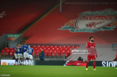 LIVERPOOL, ENGLAND - FEBRUARY 20: A dejected Mohamed Salah of Liverpool after Everton scored a goal to make it 0-2 during the Premier League match between Liverpool and Everton at Anfield on February 20, 2021 in Liverpool, United Kingdom. Sporting stadiums around the UK remain under strict restrictions due to the Coronavirus Pandemic as Government social distancing laws prohibit fans inside venues resulting in games being played behind closed doors. (Photo by Robbie Jay Barratt - AMA/Getty Images)