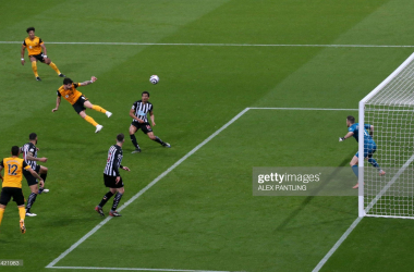 Wolverhampton Wanderers' Portuguese midfielder Ruben Neves (4th L) heads home their first goal during the English Premier League football match between Newcastle United and Wolverhampton Wanderers at St James' Park in Newcastle-upon-Tyne, north east England on February 27, 2021. - The game finished 1-1.