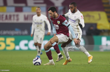 <div>Burnley's Dwight McNeil in action with Leicester City's Ricardo Pereira during the Premier League match between Burnley and Leicester City at Turf Moor, Burnley on Wednesday 3rd March 2021. (Photo by Mark Fletcher/MI News/NurPhoto via Getty Images)</div>