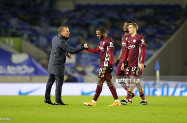 BRIGHTON, ENGLAND - MARCH 06: Leicester City Manager Brendan Rodgers with Ricardo Pereira of Leicester City, Timothy Castagne of Leicester City and Daniel Amartey of Leicester City after the Premier League match between Brighton & Hove Albion and Leicester City at American Express Community Stadium on March 6, 2021 in Brighton, United Kingdom. Sporting stadiums around the UK remain under strict restrictions due to the Coronavirus Pandemic as Government social distancing laws prohibit fans inside venues resulting in games being played behind closed doors. (Photo by Plumb Images/Leicester City FC via Getty Images)