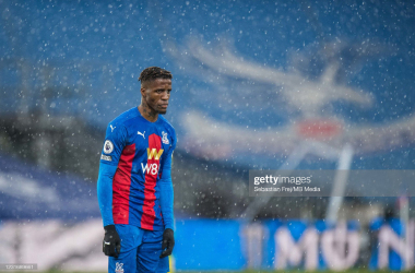 LONDON, ENGLAND - MARCH 13: Wilfried Zaha of Crystal Palace during the Premier League match between Crystal Palace and West Bromwich Albion at Selhurst Park on March 13, 2021 in London, United Kingdom. Sporting stadiums around the UK remain under strict restrictions due to the Coronavirus Pandemic as Government social distancing laws prohibit fans inside venues resulting in games being played behind closed doors. (Photo by Sebastian Frej/MB Media/Getty Images)