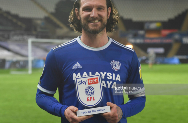 Cardiff City's Sean Morrison is presented with the Man of the Match Award following his side's victory over Swansea City / Photo by Cardiff City FC/Getty Images