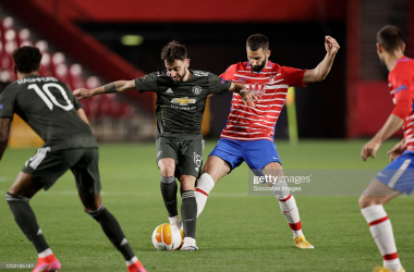 <b>GRANADA, SPAIN - APRIL 8: Bruno Fernandes of Manchester United, Maxime Gonalons of Granada CF during the UEFA Europa League match between Granada v Manchester United at the Estadio Nuevo Los Carmenes on April 8, 2021 in Granada Spain (Photo by David S. Bustamante/Soccrates/Getty Images)</b>