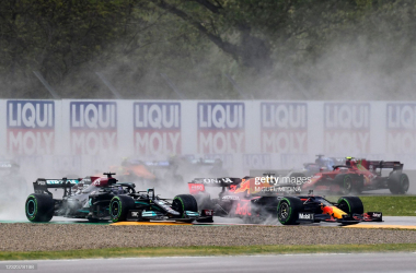 Red Bull's Dutch driver Max Verstappen (R) drives ahead of Mercedes' British driver Lewis Hamilton (L) during the Emilia Romagna Formula One Grand Prix at the Autodromo Internazionale Enzo e Dino Ferrari race track in Imola, Italy, on April 18, 2021. (Photo by Miguel MEDINA / AFP) (Photo by MIGUEL MEDINA/AFP via Getty Images)