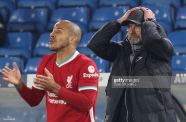 Liverpool's German manager Jurgen Klopp (R) reacts during the English Premier League football match between Leeds United and Liverpool at Elland Road in Leeds, northern England on April 19, 2021<div>(Photo by CLIVE BRUNSKILL/POOL/AFP via Getty Images)<br></div>