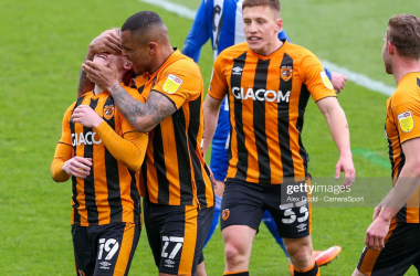 Hull City 3-1 Wigan Athletic: City champions and Wigan safe in a crazy day in League One