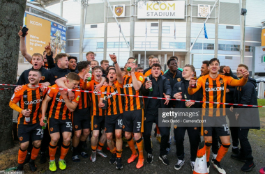 HULL, ENGLAND - MAY 01: Hull City players celebrate with the fans after the match during the Sky Bet League One match between Hull City and Wigan Athletic at KCOM Stadium on May 1, 2021 in Hull, England. (Photo by Alex Dodd - CameraSport via Getty Images)